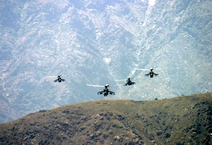Attack helicopters flying over mountains, Kabul