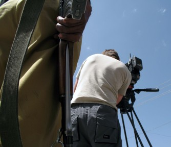 Western cameraman operating under watchful eye of the authorities, Quetta, Baluchistan Province, Pakistan