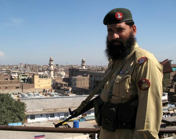 Member of Frontier Corps overlooking Peshawar, Pakistan