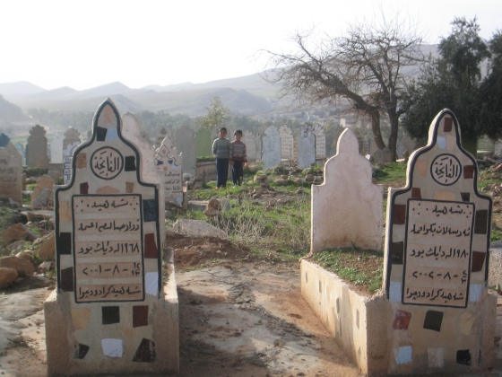 Two boys stand in a Peshmurgah graveyard. 04