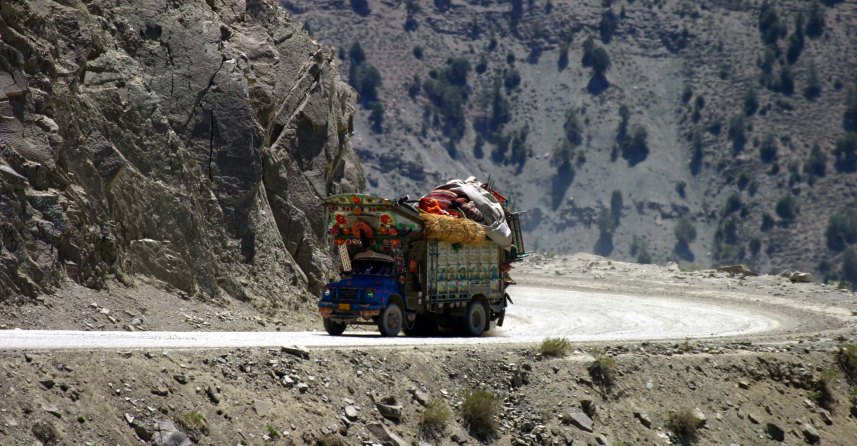 Truck with Afghan Kuchi family 04